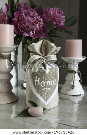 bag with bow and embroidered hearts, candles - stock photo