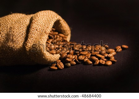 Bag with fresh coffee beans - stock photo