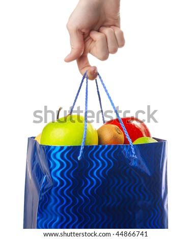 Bag with fruits hanging on finger - stock photo