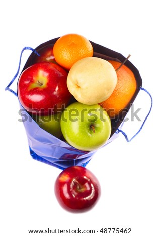 Bag with fruits isolated on white background - stock photo