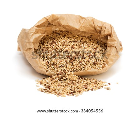 Bag with raw brown wholegrain rice isolated on white