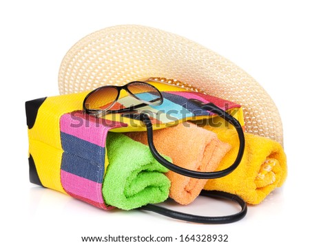 Bag with towels, sunglasses and hat. Isolated on white background - stock photo