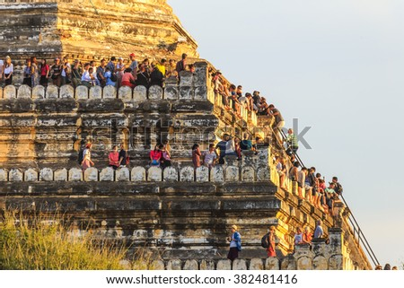 Bagan, MYANMAR - DEC 21: crowded tourist at Shwesandaw temple at the archaeological site of Bagan, Myanmar on December 21, 2014 - stock photo