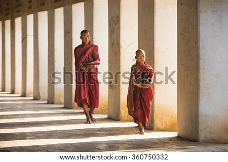 BAGAN,MYANMAR -DEC 13 ; Monk of Buddhist walking on Shwezigon temple after finish received food from Buddisht people on Dec 13,2015  . Bagan , Myanmar