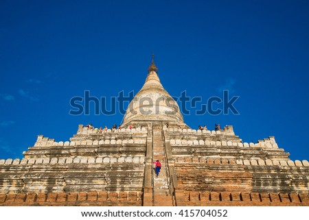 Bagan, MYANMAR - JAN 14: crowded tourist at Shwesandaw temple at the archaeological site of Bagan, Myanmar on January 14, 2015 - stock photo
