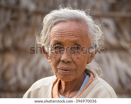 BAGAN, MYANMAR - JANUARY 21, 2016: Unidentified old woman who participated in the donation channeled ceremony Shinbyu, marking the samanera ordination of a boy under the age of 20