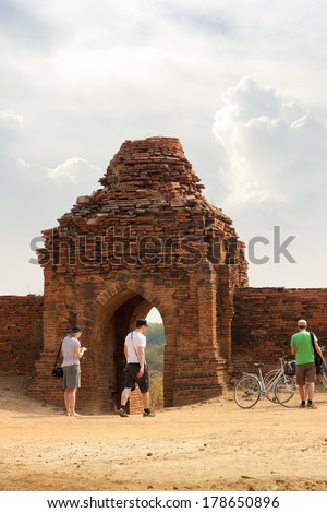 BAGAN, MYANMAR - MAR 7: European tourist explore the Old Bagan valley on Mar 7, 2013, Old Bagan contains thousands of ancient pagodas and temples , all UNESCO protected - stock photo