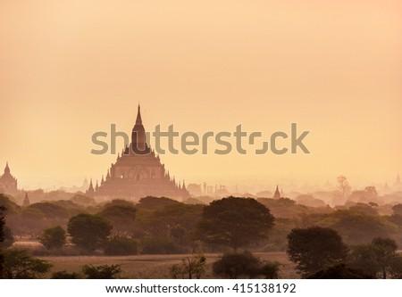 Bagan, Myanmar - March 12th 2016 - The temples of Bagan in the sunrise in Bagan City, Myanmar, Asia. - stock photo