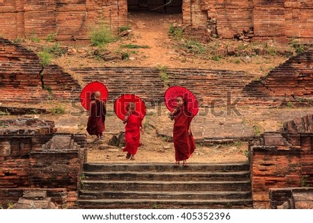 BAGAN, MYANMAR March 12: Unidentified young Buddhism novices at Shwezigon temple on March 12, 2016 in Bagan. Buddhism is predominantly of the Theravada tradition, practised by 80% of the population. - stock photo