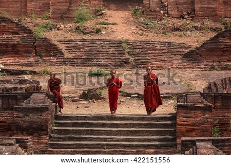 BAGAN, MYANMAR March 12: Unidentified young Buddhism novices at Shwezigon temple on March 12, 2016 in Bagan. Buddhism is predominantly of the Theravada tradition, practised by 80% of the population - stock photo