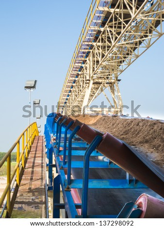 Bagasse handling with conveyor - stock photo