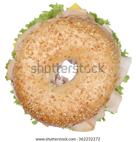 Bagel sandwich for breakfast with ham, cream cheese, tomatoes and lettuce top view isolated on a white background - stock photo