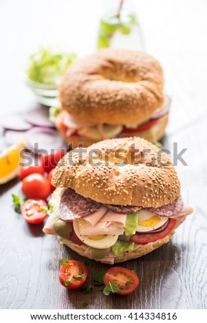 Bagel sandwiches with turkey breast and vegetables,selective focus  - stock photo
