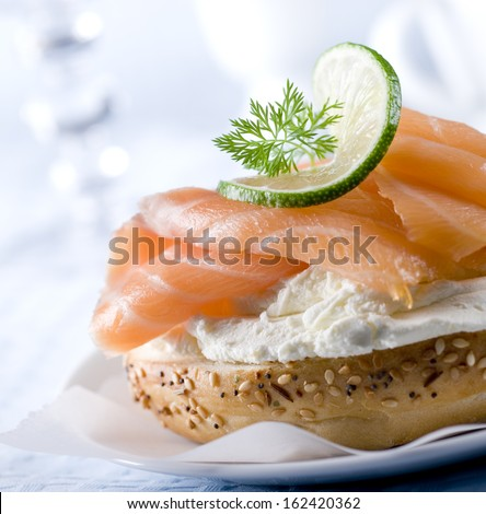 Bagel with fresh smoked salmon and cream cheese. - stock photo