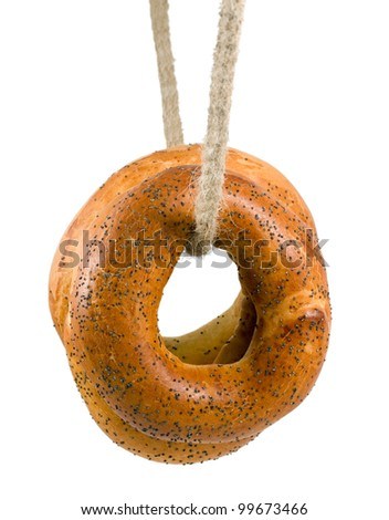 bagel with poppy seeds in rope isolated on white background - stock photo