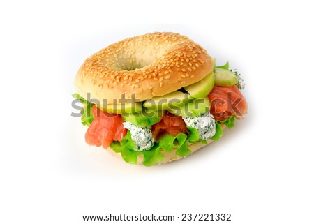 Bagel with salmon, fresh salad leaf, green apple and herbed cream cheese, isolated - stock photo