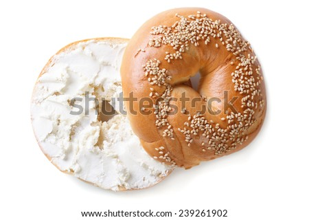 bagel with sesame and cream cheese isolated on white background. top view  - stock photo
