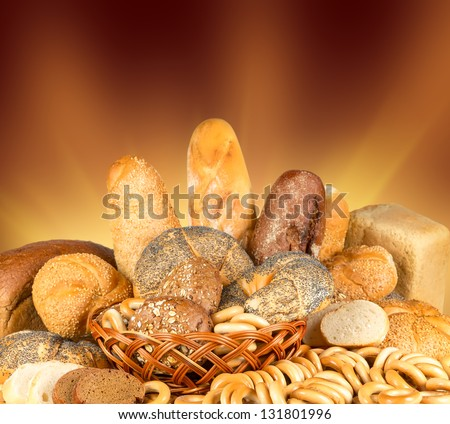 Bagels and bread in a wicker basket - stock photo