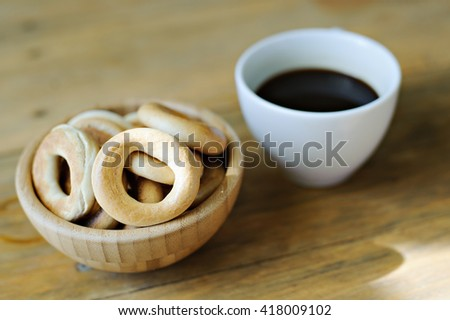Bagels and coffee on wooden background. - stock photo