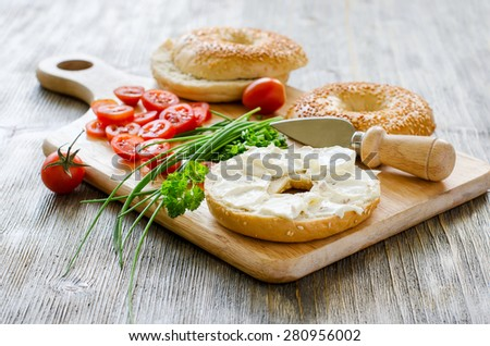 Bagels sandwiches with cream cheese, tomatoes and chives for healthy vegetarian snack - stock photo