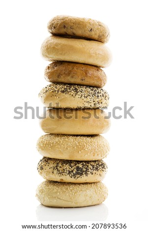 Bagels with poppy seeds bagels with sesame wholemeal bagels on white background - stock photo