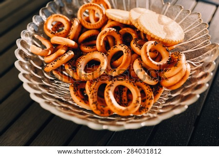 Bagels with poppy seeds on a plate on the black table - stock photo