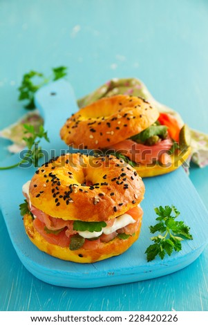 Bagels with salmon and cream cheese. - stock photo