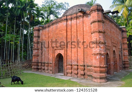BAGERHAT, BANGLADESH - DECEMBER 19: Zindapir Mosque on December 19, 2012 in Bagerhat, Bangladesh. Hindu Temple. Zindapir Mosque is a single-domed mosque and made of bricks.