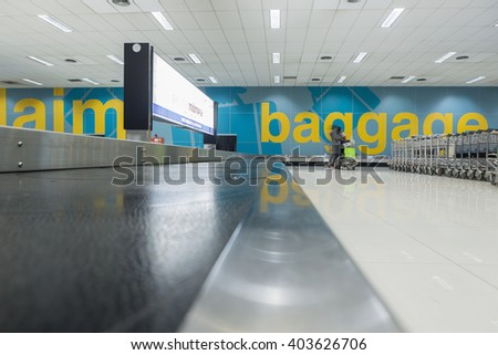 Baggage claim area. Airport terminal with baggage carousels for travelers - stock photo