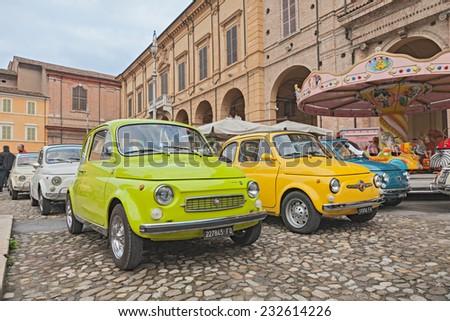 "BAGNACAVALLO, RA, ITALY - NOVEMBER 9: vintage italian cars Fiat 500 Lombardi and Abarth in classic car rally at the feast ""Sagra dei sapori d'autunno"" on November 9, 2014 in Bagnacavallo, RA, Italy  - stock photo"