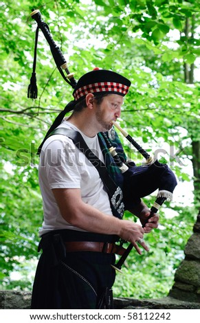 Bagpiper in the Woods