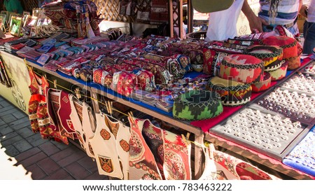 Bags, headgear, boxes made of traditional fabrics of Armenian patterns and colors lying on the stalls at the Yerevan market in Armenia
