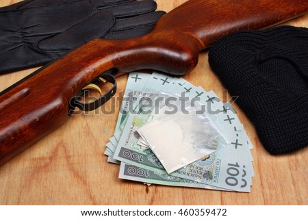 Bags of drugs,  euro money and gun on a wooden table - stock photo
