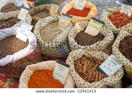 Bags of spices at a market in Provence - stock photo