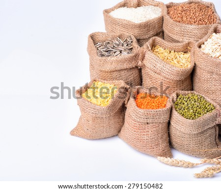 bags with cereal grains  (seeds, rice, buckwheat, oatmeal, lentils) - stock photo