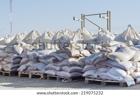 Bags with freight on pallets, warehouse. - stock photo