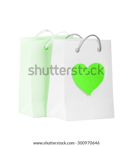 Bags with green heart for purchases on the white