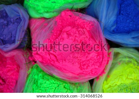 Bags with Indian dyes on Holi color festival - stock photo