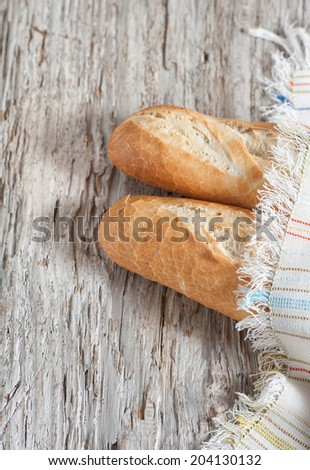 Baguette on the wooden board
