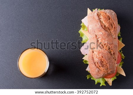 baguette sandwich with orange juice - stock photo