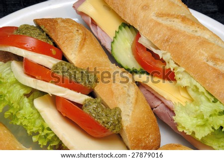 baguette sandwiches with lettuce, tomatoes, ham, cheese and mustard