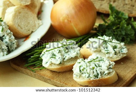 Baguette slices with spread - stock photo