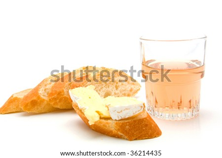 baguette with french cheese and ros? wine isolated on white background