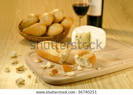 baguettes cheese and wine - stock photo