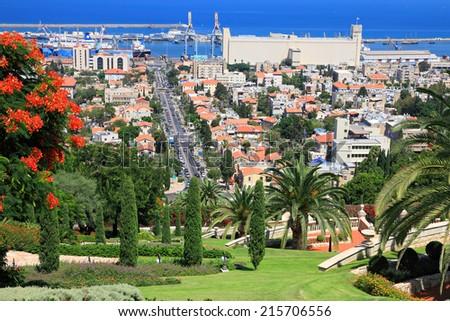 Bahai gardens on the slopes of the Carmel Mountain and view of the Mediterranean Sea, Haifa city and harbor, Israel  - stock photo