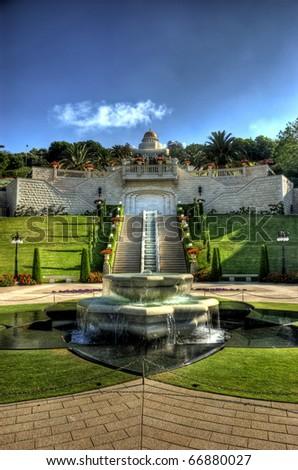 Bahaian Gardens Baha'i Shrine in Haifa on the coast of Israel. The Baha'i faith preaches unity of all world religions. - stock photo