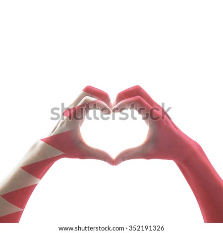 Bahrain flag pattern on people hands in heart shape on vintage blue sky background, symbolic sign language expressing love, unity, harmony of people in country/ nation: Happy National day concept - stock photo