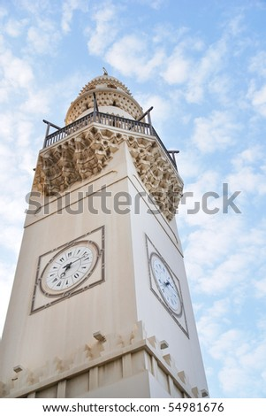Bahrain - Minaret with clock in city center - stock photo
