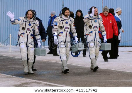 BAIKONUR, KAZAKHSTAN - DECEMBER 21, 2011: Expedition 31 crew (D.Pettit, O.Kononenko, A.Kuipers) walk out to report that they are ready for the flight to ISS at Baikonur cosmodrome - stock photo