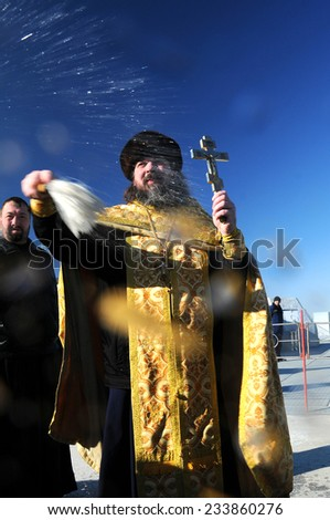 BAIKONUR, KAZAKHSTAN - NOVEMBER 22, 2014: Group of photographers receive blessing from Orthodox priest Father Sergius following Soyuz TMA-15M spacecraft blessing - stock photo